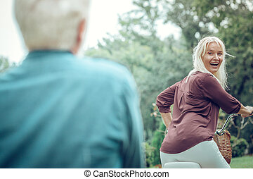 Happy delighted woman looking at her husband