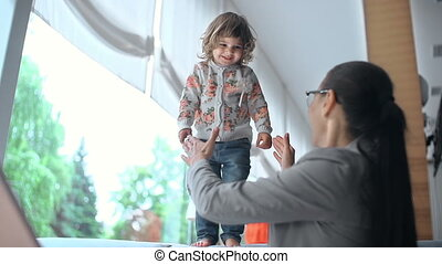 Catch Me - Low angle of little girl jumping down caught by...