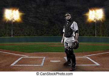 Catcher Baseball Player on a baseball Stadium.