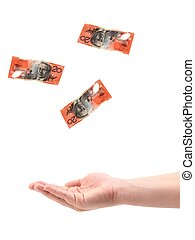 Catching Cash - A female hand catching cash isolated against...