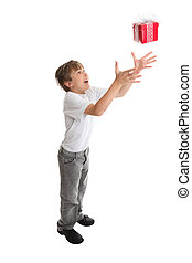 Catching falling present - A child reaches high to catch a...