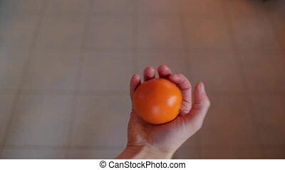 Catching on orange - Catching an orange thrown into hand