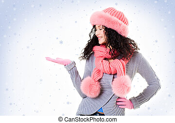 Catching snowflakes - Cheerful woman in pink winter fur cap...