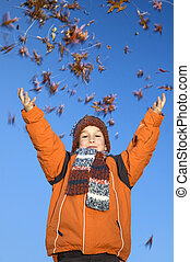 Catching The Autumn Leaves - This boy is happy that the ...