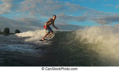 Catching Waves - Wake surfer approaching camera in motion