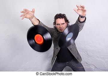 Catchy Tunes - DJ throwing two vinyl records