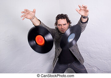 Catchy Tunes - DJ throwing two vinyl records