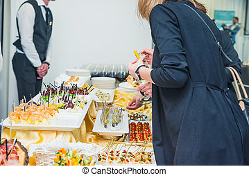 Catering buffet table with food and snacks for guests of the...
