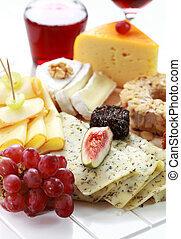 Catering cheese platter with red wine