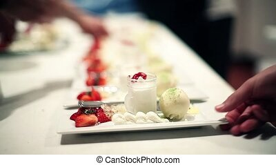 catering desserts - catering company preparing large numbers...