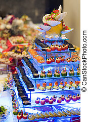 Catering food - different sorts of appetizers (sushi, ...