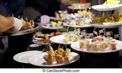 catering adding food in cocktail party