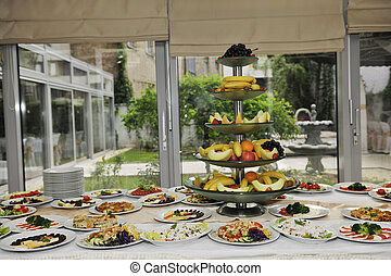 catering food - delicius catering food arrangement on party...