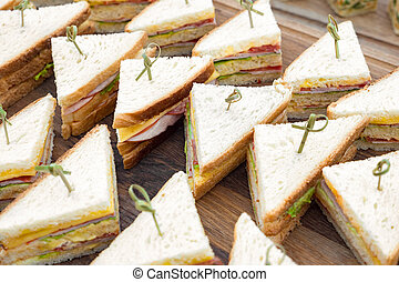 Catering menu. Snacks, sliders for breakfast and lunch. Business lunch background. Vegan sliders, ham and vegetable slider bar. Buffet food for party catering. Sandwich tray