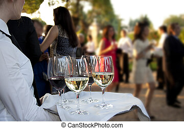 Catering - Professional catering service serving drinks to...