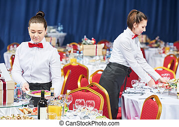 Catering restaurant waitress serving table with food