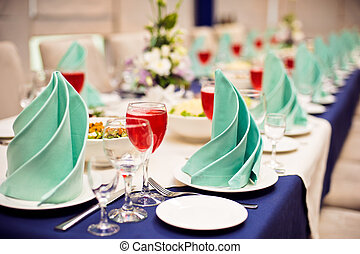 Catering service. Restaurant table with food. Huge amount of on the . Plates . Dinner time.