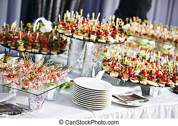 catering service table with food set