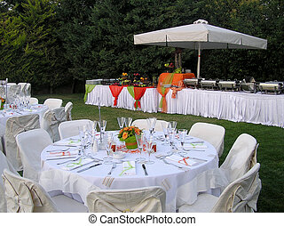 overview of wedding catering area, tables and banquet visible, with decorations