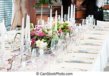 catering table set with flowers