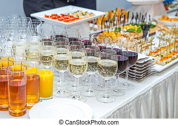 Catering table with alcoholic and non-alcoholic drinks,...