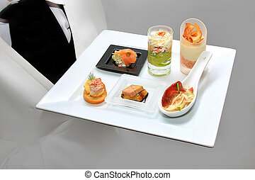 Catering waiter with canapes on pla - Catering waiter with...