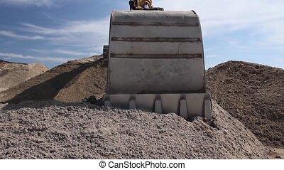 Caterpillar in action. - Excavator is working on...