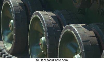 Caterpillar tank wheels close up.