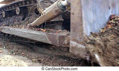 Caterpillars and bucket of excavator