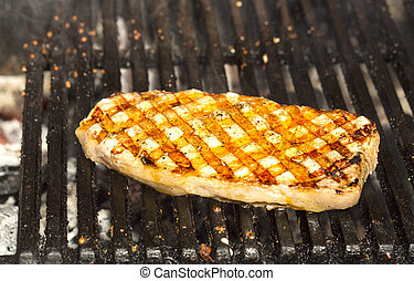 Catfish steak cooking on the grill