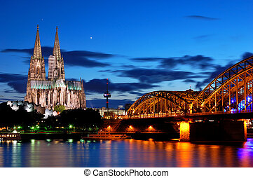 Cologne, Germany - Cathedral and Hohenzollern Bridge in...