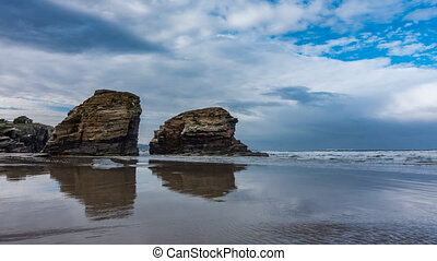 Cathedral beach time-lapse with rocks in Galicia, top view...