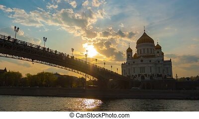 Cathedral of Christ the Saviour and Patriarshy Bridge in Moscow on a sunset, timelapse