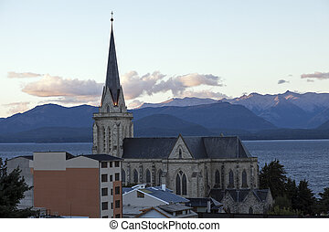 Cathedral of San Carlos de Bariloche - and the sunset over Nahuel Huapi Lake.