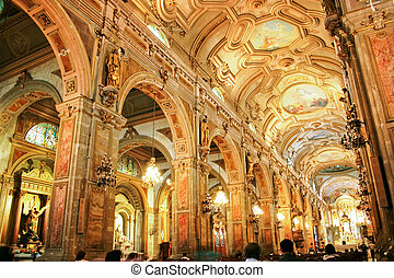 The golden interior of the Cathedral of Santiago, capital of Chile.