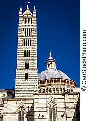 Cathedral of Siena in the summer on a blue sky background