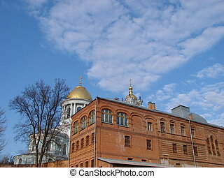 Cathedral red brick wall under deep blue sky