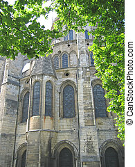 Cathedral view of the back with a tree in foreground, Bourges, France
