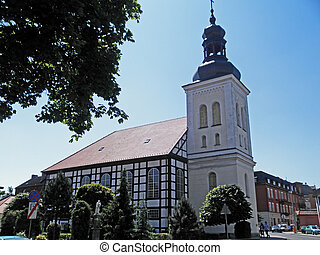 Catholic Church in Poland, half-timbered building with a ...