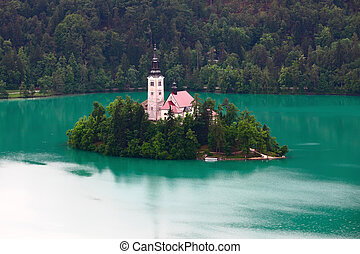 Bled lake - Catholic church situated on an island on Bled ...