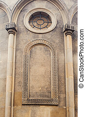 Catholic church wall with columns and round window