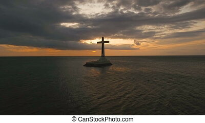 Catholic cross in the sea. - Aerial view Sunken Cemetery ...