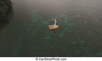Catholic cross in the sea. - Aerial view Sunken Cemetery...