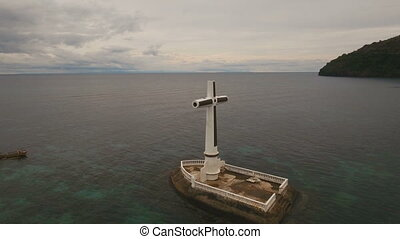 Catholic cross in the sea. - Aerial view Sunken Cemetery...