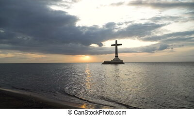 Catholic cross in the sea. - Sunken Cemetery cross in...