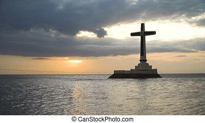 Catholic cross in the sea.