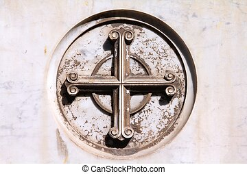 Catholic cross symbol on a grave in Campo Verano cemetery,...