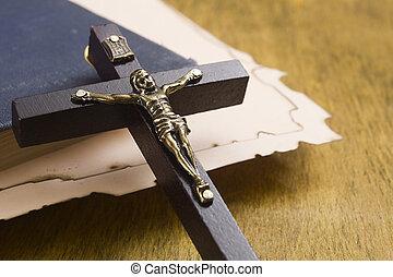 Catholic cross with a crucifix on manuscripts - Catholic...