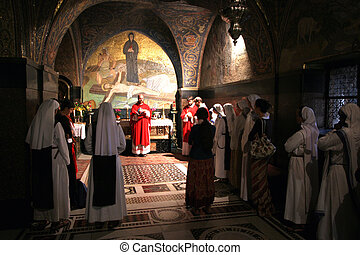 Catholic Mass at the 11th Stations of the Cross in the Church of the Holy Sepulchre. Jerusalem