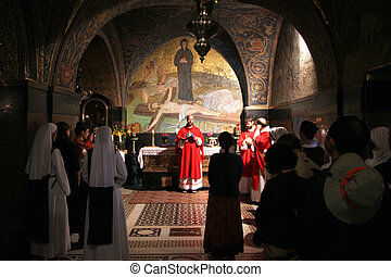 Catholic Mass at the 11th Stations of the Cross in the Church of the Holy Sepulchre. Jerusalem.